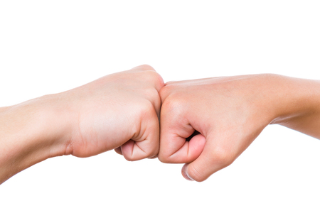 Photo for Close-up hands of boy and girl are banging their fists. Fist bump isolated on white background. - Royalty Free Image