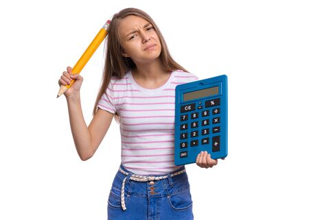 Photo pour Thoughtful student holding big calculator and pencil. Portrait of funny cute teen girl, isolated on white background. Unhappy dreaming child Back to school. - image libre de droit
