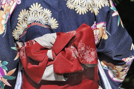 Blue kimono with red munsuko and red obi, traditional Japanese dress
