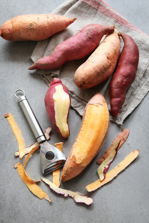Photo for Two varieties of sweet potatoes on grey background - Royalty Free Image