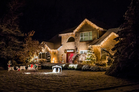 Photo for Decorated house for Christmas at night covered in snow - Royalty Free Image