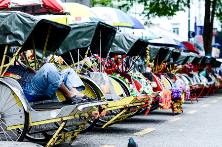 Photo for Vintage Trishaw stop beside road for service traveller - Royalty Free Image