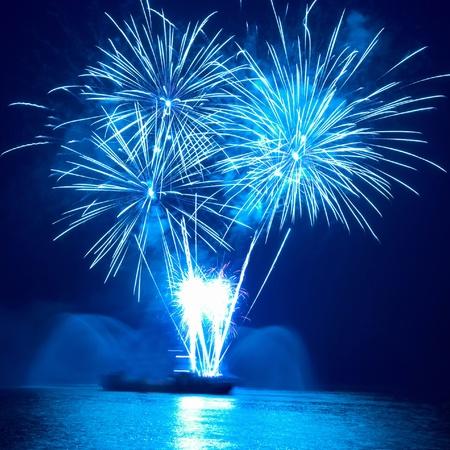 Photo pour Colorful fireworks on the black sky background - image libre de droit