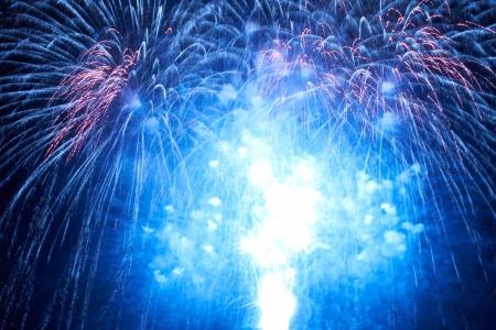 Photo pour Blue colorful fireworks on the black sky background - image libre de droit