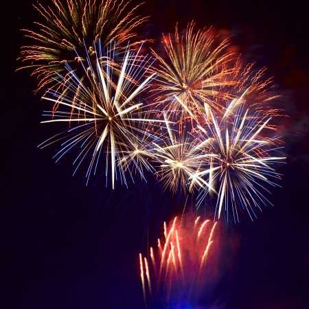 Photo pour Red colorful fireworks on the black sky background - image libre de droit