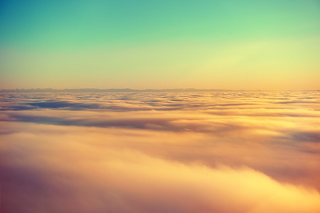 Foto de Amazing view from plane on the orange sky, sunset sun and clouds - Imagen libre de derechos