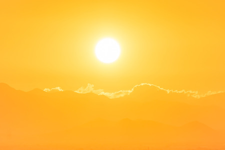 Photo for Sunset over clouds. Big orange sun can be used for natural background - Royalty Free Image