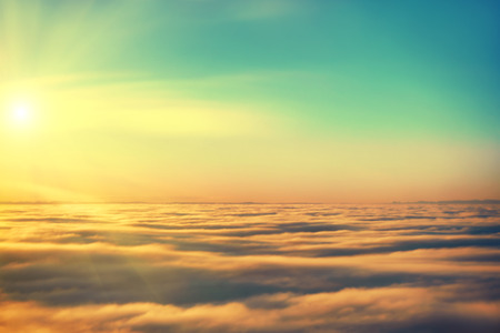 Photo pour Amazing view from plane on the sky, sunset sun and clouds - image libre de droit