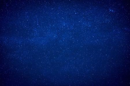 Foto de Blue dark night sky with many stars. Milky way like space background - Imagen libre de derechos