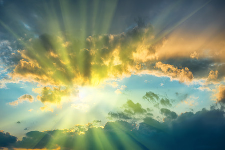 Photo for Beautiful blue sky with sun shining through clouds - Royalty Free Image