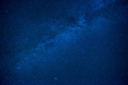 Foto de Blue dark night sky with many stars. Milkyway cosmos background - Imagen libre de derechos