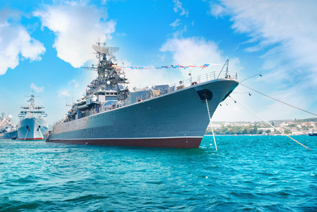 Foto de Military navy ship in the bay. Military sea landscape with blue sky and clouds - Imagen libre de derechos