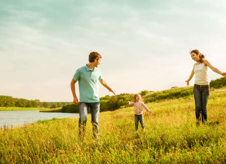 Photo pour happy family having fun outdoors - image libre de droit