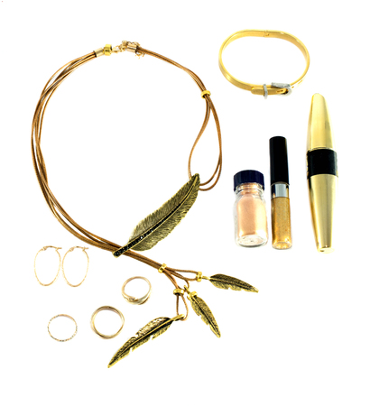 Foto de set of gold accessories and cosmetics on a white background - Imagen libre de derechos