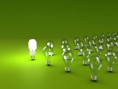 Foto de Energy saving and simple light bulbs isolated on green background. - Imagen libre de derechos