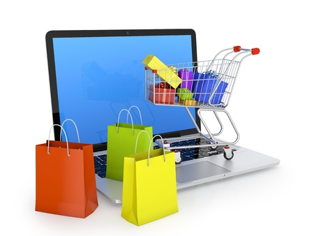 Photo for Laptop with shopping bags, shopping cart, and gift boxes isolated on white  Electronic commerce concept  - Royalty Free Image
