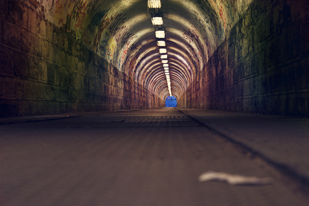 urban tunnel with graffiti and light