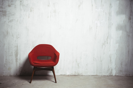 Photo for red armchair near the old textured gray wall - Royalty Free Image