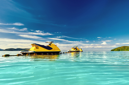 Foto per Yellow Jet ski on the sea and blue sky and small islands in background. - Immagine Royalty Free