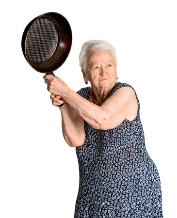 Photo pour Angry old woman with a pan on a white background - image libre de droit