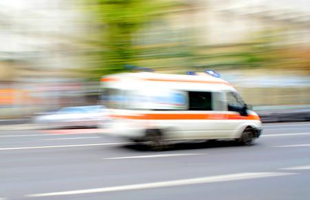 Foto de Ambulance in motion driving down the road. Intentional motion blur - Imagen libre de derechos