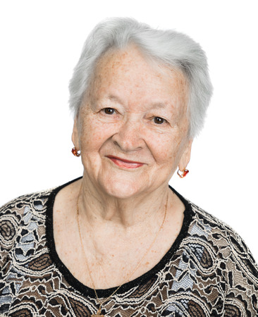 Foto de Portrait of a beautiful smiling senior woman over white background - Imagen libre de derechos