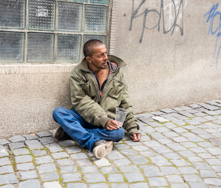 Photo for Homeless man on the street of the city. Senior beggar - Royalty Free Image