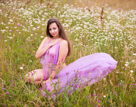 Photo for Young nude woman in pink shawl posing on the field. Sexy blonde enjoying nature and summer time outdoors - Royalty Free Image