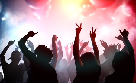 Photo pour Silhouettes of young people dancing in club. Disco and party concept. - image libre de droit