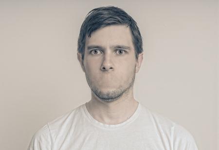 Photo pour Censorship concept. Face of young man without mouth. - image libre de droit