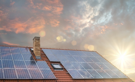 Photo pour Photovoltaic or solar panels on roof at sunset. - image libre de droit