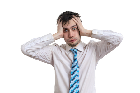 Photo for Worried businessman is holding his head. Isolated on white background. - Royalty Free Image