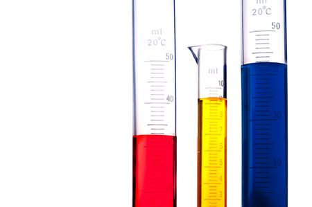 Three graduated cylinders of different colored chemicals