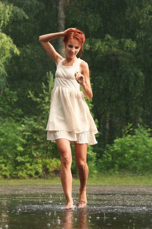 happy young woman in the rain without an umbrella