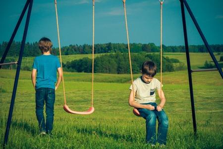 Foto de Kids relationship difficulties. Child falls out with a friend. - Imagen libre de derechos
