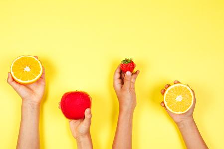 Foto de Healthy food concept. Many kids hands with fuits. Top view - Imagen libre de derechos