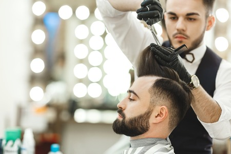 Photo for Barber doing haircuts for client - Royalty Free Image