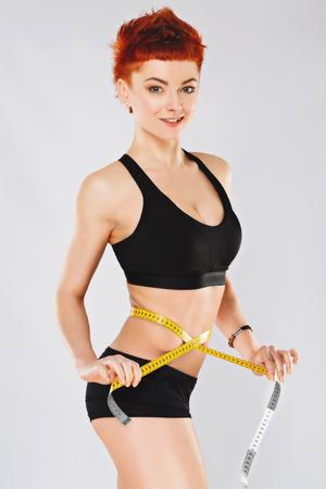 Foto de Sportive girl at gray background - Imagen libre de derechos