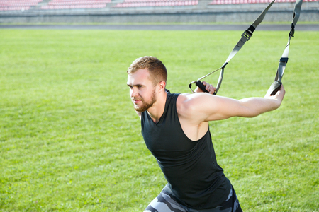Photo for Man lunging with training loop - Royalty Free Image