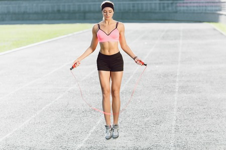 Photo for Young girl jumping on skipping rope - Royalty Free Image