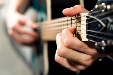 Photo for musician playing on the acoustic guitar - Royalty Free Image