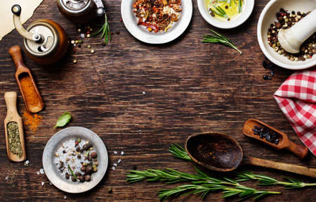 Photo for Spices for use as cooking ingredients on a wooden background, with copyspace - Royalty Free Image