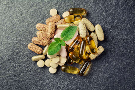Photo pour pills and multivitamins  on a black background - image libre de droit
