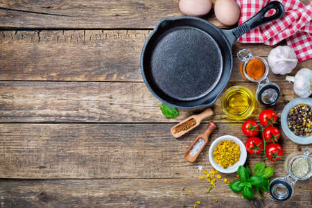 Photo for Ingredients for cooking and cast iron skillet on an old wooden table. Food background concept with copyspace - Royalty Free Image
