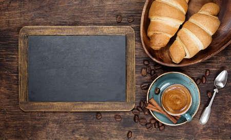 Photo pour Croissants and coffee  with vintage blackboard with copyspace - image libre de droit