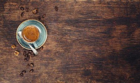 Photo pour Espresso in a blue bowl  on a wooden background - image libre de droit