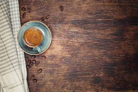 Photo for Coffee with crema on a rustic dark background - Royalty Free Image