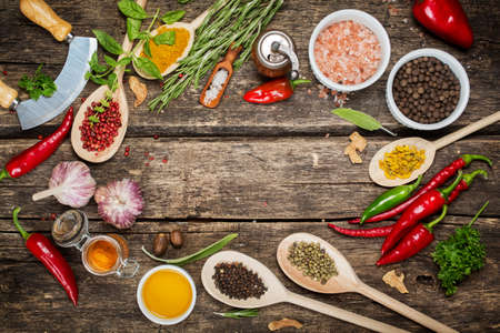Photo for Various spices and herbs with copyspace, pink pepper, Himalayan salt, garlic and olive oil - Royalty Free Image