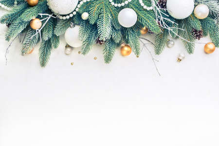 Photo for Christmas Tree Pine Branches and Christmas balls on a light background. - Royalty Free Image