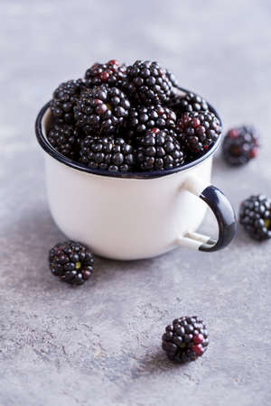 Photo for Juicy fresh blackberries in a cup. Organic healthy berries. Selective focus - Royalty Free Image